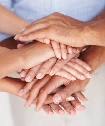Closeup of a group of people's hands together