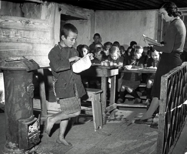 A young boy reading allowed to the class